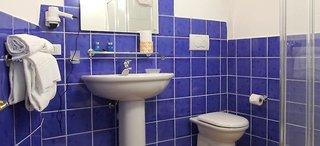 Hotel Li Graniti Badezimmer