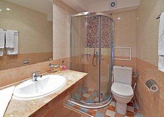 Hotel COOEE Mimosa Sunshine Badezimmer